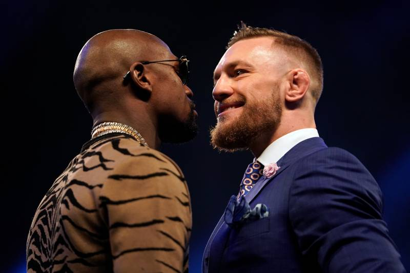LONDON, ENGLAND - JULY 14: (R-L) Conor McGregor and Floyd Mayweather Jr. face off during the Floyd Mayweather Jr. v Conor McGregor World Press Tour event at SSE Arena on July 14, 2017 in London, England. (Photo by Jeff Bottari/Zuffa LLC/Zuffa LLC via Getty Images)