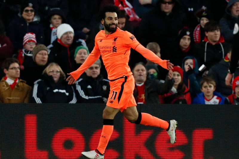 Epl table 2018 premier league standings after sundays week 27 liverpools egyptian midfielder mohamed salah celebrates scoring their second goal during the english premier league football stopboris Choice Image