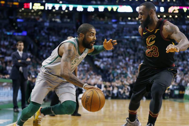 95984e51c8e5 Boston Celtics  Kyrie Irving drives past Cleveland Cavaliers  LeBron James  (23) during
