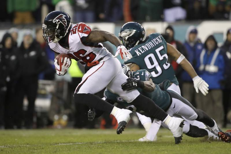d0cb8ad7457e7 Atlanta Falcons  Tevin Coleman tries to slip past Philadelphia Eagles   Malcolm Jenkins during the
