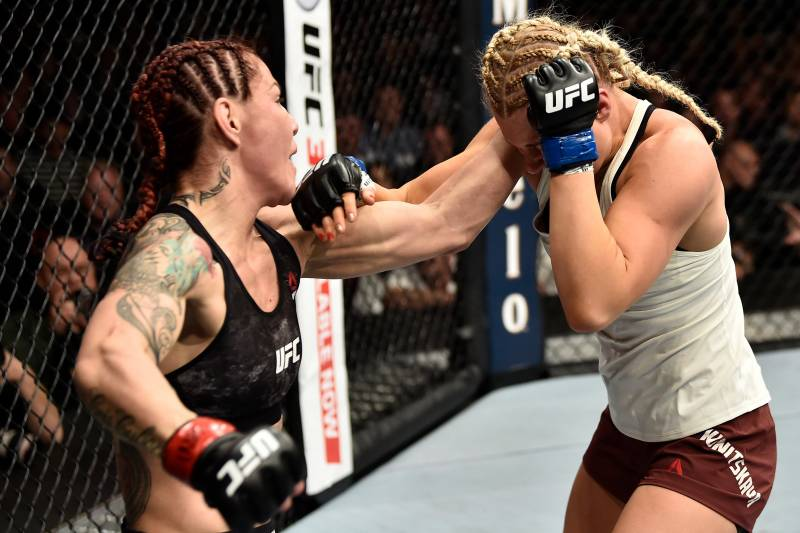 LAS VEGAS, NV - MARCH 03: (L-R) Cris Cyborg of Brazil punches Yana Kunitskaya of Russia in their women's featherweight bout during the UFC 222 event inside T-Mobile Arena on March 3, 2018 in Las Vegas, Nevada. (Photo by Jeff Bottari/Zuffa LLC/Zuffa LLC via Getty Images)
