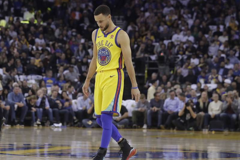 Golden State Warriors guard Stephen Curry (30) walks on the court to shoot free throws during the first half of an NBA basketball game against the San Antonio Spurs in Oakland, Calif., Thursday, March 8, 2018. (AP Photo/Jeff Chiu)