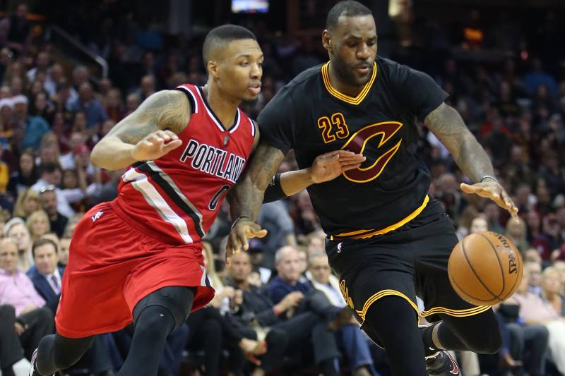 7ea4195ee36 Cleveland Cavaliers forward LeBron James (23) drives on Portland Trail  Blazers guard Damian Lillard