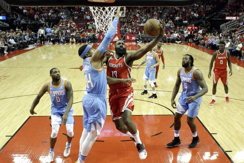 0450ae688678 Houston Rockets  James Harden (13) goes up for a shot as LA Clippers