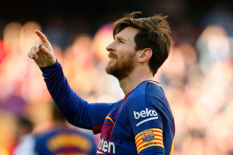 12904bba1 Barcelona s Argentinian forward Lionel Messi celebrates after scoring  during the Spanish League football match between FC
