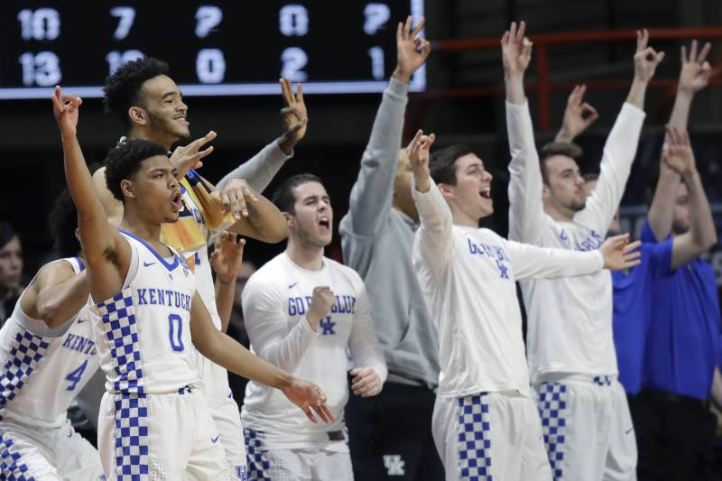 d3b6f682c338 Players on the Kentucky bench react during the second half of a  second-round game