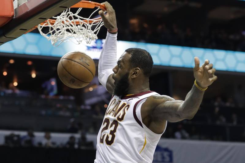 a17f8bd9edaa Cleveland Cavaliers  LeBron James (23) dunks against the Charlotte Hornets  during the second