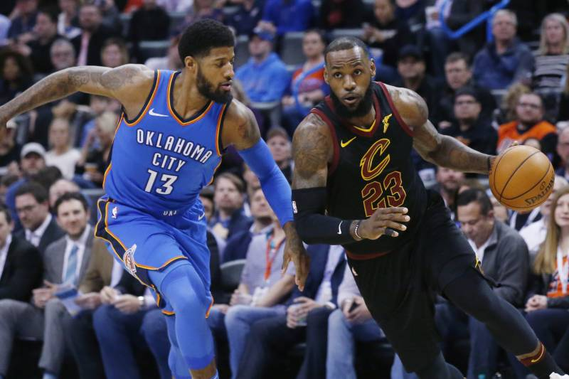 e28a65656ad Cleveland Cavaliers forward LeBron James (23) drives past Oklahoma City  Thunder forward Paul George