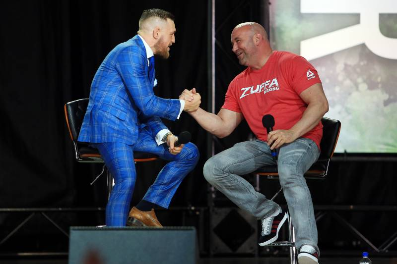 TORONTO, ON - JULY 12: Conor McGregor shakes hands with UFC President Dana White during the Floyd Mayweather Jr. v Conor McGregor World Press Tour at Budweiser Stage on July 12, 2017 in Toronto, Canada. (Photo by Vaughn Ridley/Getty Images)