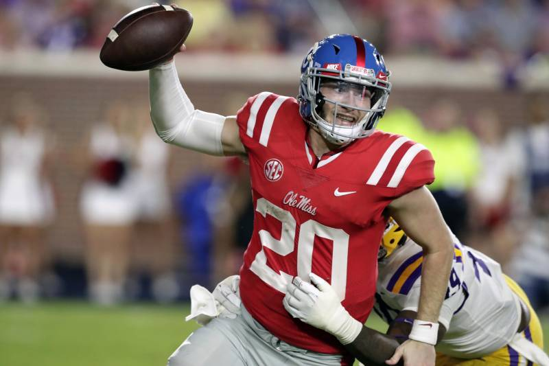 b325903bf Mississippi quarterback Shea Patterson (20) is sacked by LSU linebacker  Arden Key (49