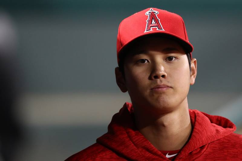 ARLINGTON, TX - APRIL 09:  Shohei Ohtani #17 of the Los Angeles Angels in the dugout during play against the Texas Rangers at Globe Life Park in Arlington on April 9, 2018 in Arlington, Texas.  (Photo by Ronald Martinez/Getty Images)
