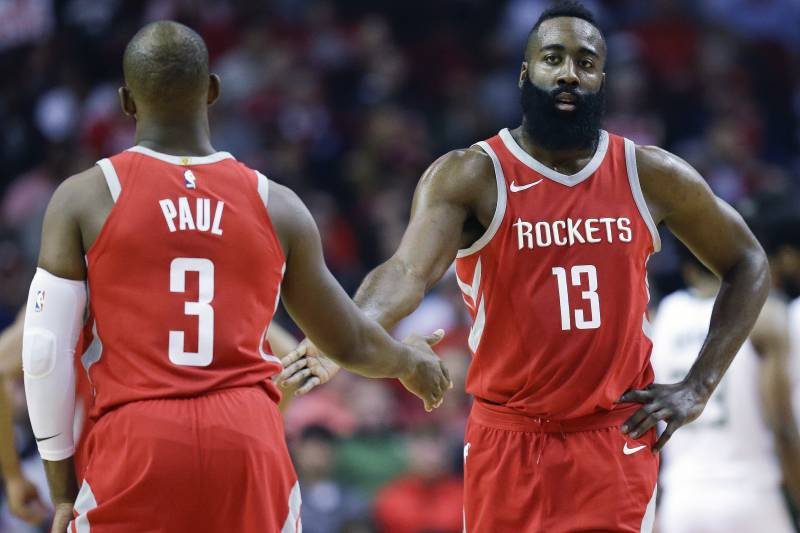 234e8b0f6aa Houston Rockets guard James Harden (13) shakes hands with Chris Paul after  a foul