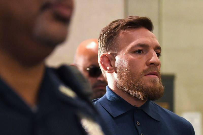 Irish Mixed Martial Arts fighter Conor McGregor leaves the Kings County (Brooklyn) Criminal Court on April 6, 2018 in New York. Irish Mixed Martial Arts fighter Conor McGregor was charged with assault and criminal mischief by New York police on April 6, 2018 and was due to appear in court. The 29-year-old superstar reportedly surrendered at a Brooklyn police station late Thursday after allegedly attacking a shuttle bus loaded with fellow mixed martial arts fighters attending a New York media event at the Barclays Center stadium.Video footage showed McGregor hurling a dolly through a side window of the bus as it moved slowly in a parking lot at the stadium in Brooklyn. / AFP PHOTO / ANGELA WEISS (Photo credit should read ANGELA WEISS/AFP/Getty Images)