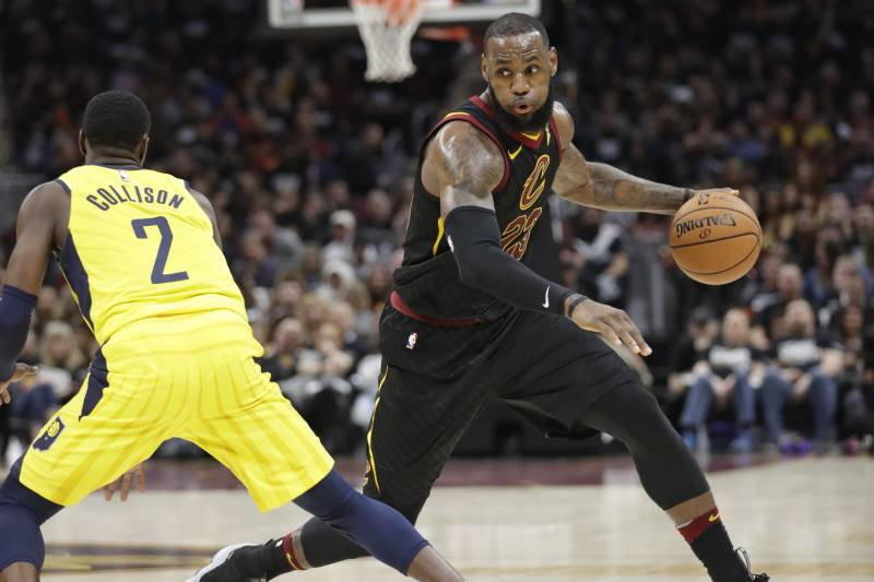b26352a5978 Cleveland Cavaliers  LeBron James (23) drives around Indiana Pacers  Darren  Collison (