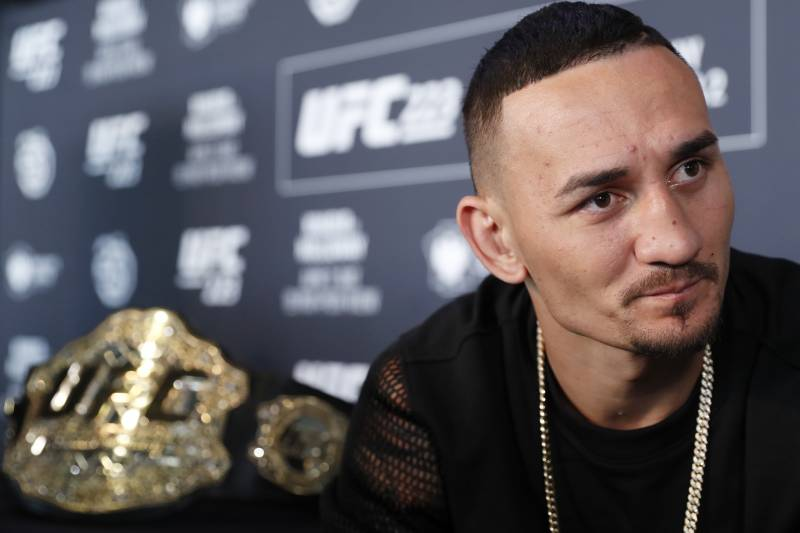 UFC featherweight champion Max Holloway responds to reporters' questions during a media event, Thursday, April 5, 2018, in New York, ahead of his lightweight title fight against Max Nurmamogedov, Saturday, April 7th. (AP Photo/Kathy Willens)