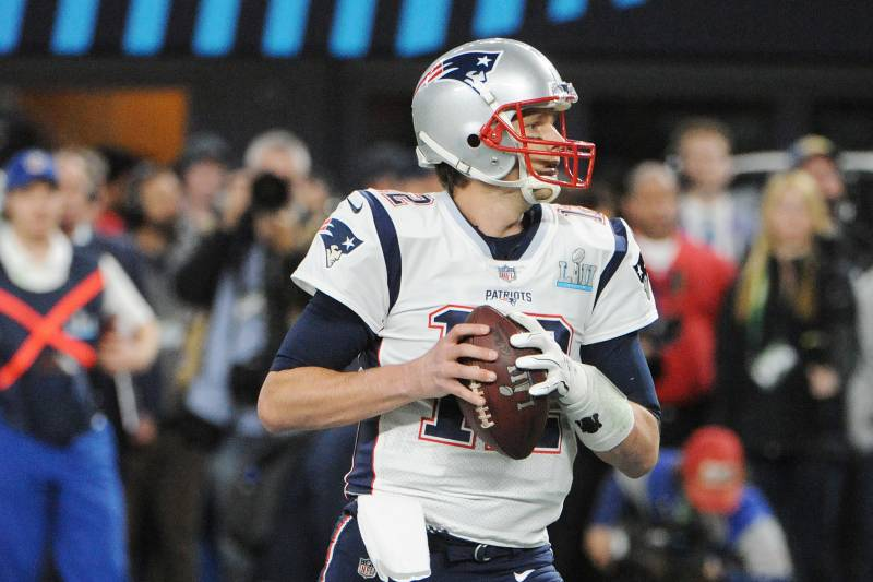 MINNEAPOLIS, MN - FEBRUARY 04: Tom Brady #12 of the New England Patriots drops back to pass against the Philadelphia Eagles during Super Bowl LII at U.S. Bank Stadium on February 4, 2018 in Minneapolis, Minnesota. The Eagles defeated the Patriots 41-33. (Photo by Focus on Sport/Getty Images) *** Local Caption *** Tom Brady