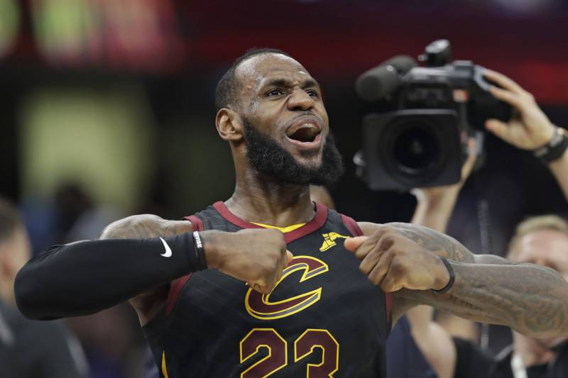 4014cb094fa9 Cleveland Cavaliers  LeBron James celebrates after scoring the game-winning  shot in the second