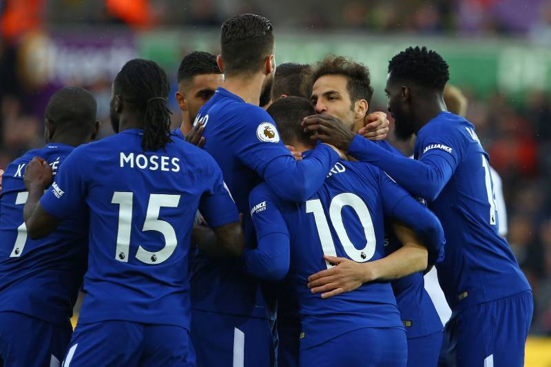 cc842cc261840 Chelsea's Spanish midfielder Cesc Fabregas (2nd R) celebrates with  teammates after scoring the opening