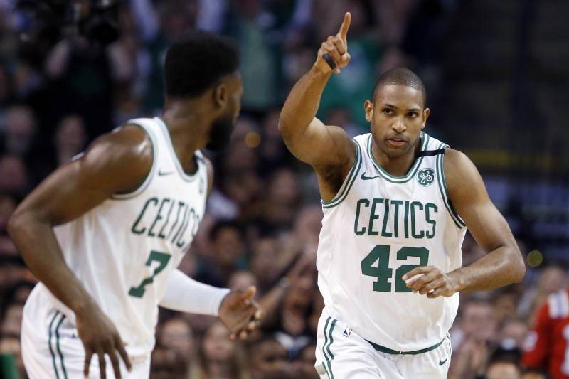 66c6d87c659d Boston Celtics forward Al Horford (42) celebrates a made basket with guard  Jaylen Brown