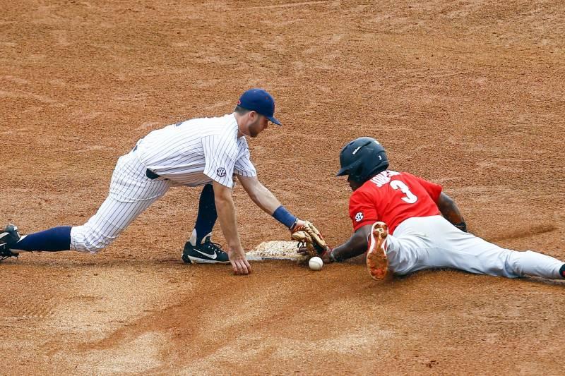 402ee96317d Georgia s Ivan Johnson (3) slides safely into second base as Mississippi  infielder Jacob Adams