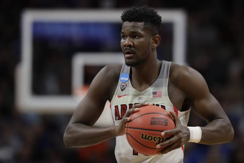3c4c6cf07 Arizona forward Deandre Ayton holds the ball against Buffalo during the  first half of a first