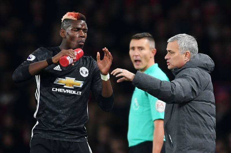 LONDON, ENGLAND - DECEMBER 02:  Jose Mourinho, Manager of Manchester United speaks to Paul Pogba of Manchester United during the Premier League match between Arsenal and Manchester United at Emirates Stadium on December 2, 2017 in London, England.  (Photo by Laurence Griffiths/Getty Images)