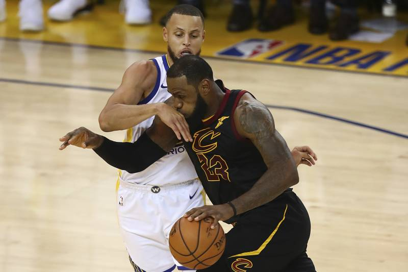 buy online 7ea6f 24ef9 Cleveland Cavaliers forward LeBron James (23) drives against Golden State  Warriors guard Stephen Curry