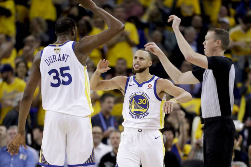 497866130415 Golden State Warriors forward Kevin Durant (35) celebrates with guard  Stephen Curry (30