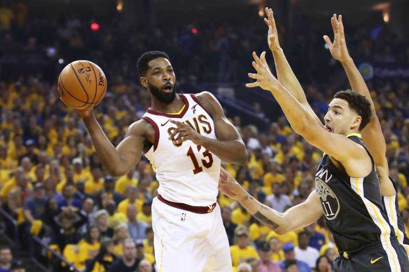 OAKLAND, CA - JUNE 03:  Tristan Thompson #13 of the Cleveland Cavaliers passes against Klay Thompson #11 of the Golden State Warriors in Game 2 of the 2018 NBA Finals at ORACLE Arena on June 3, 2018 in Oakland, California. NOTE TO USER: User expressly acknowledges and agrees that, by downloading and or using this photograph, User is consenting to the terms and conditions of the Getty Images License Agreement.  (Photo by Ezra Shaw/Getty Images)