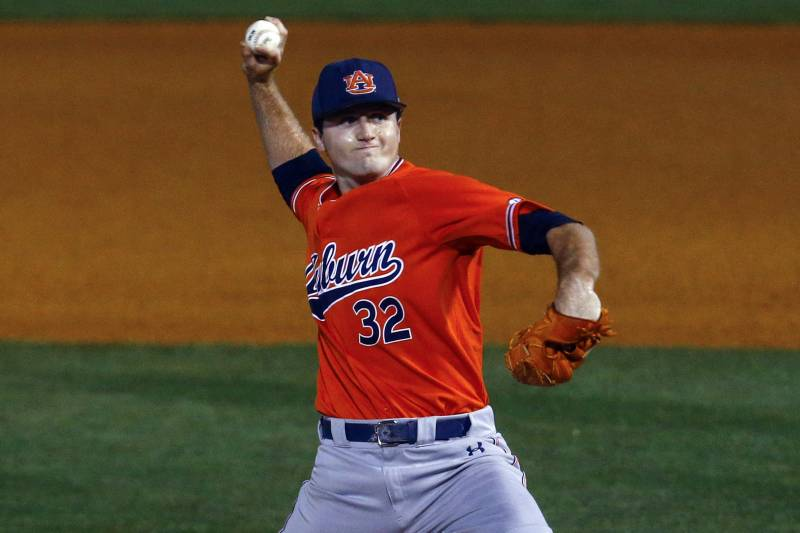 d59015c25 Auburn pitcher Casey Mize throws a pitch during the first inning of a  Southeastern Conference tournament