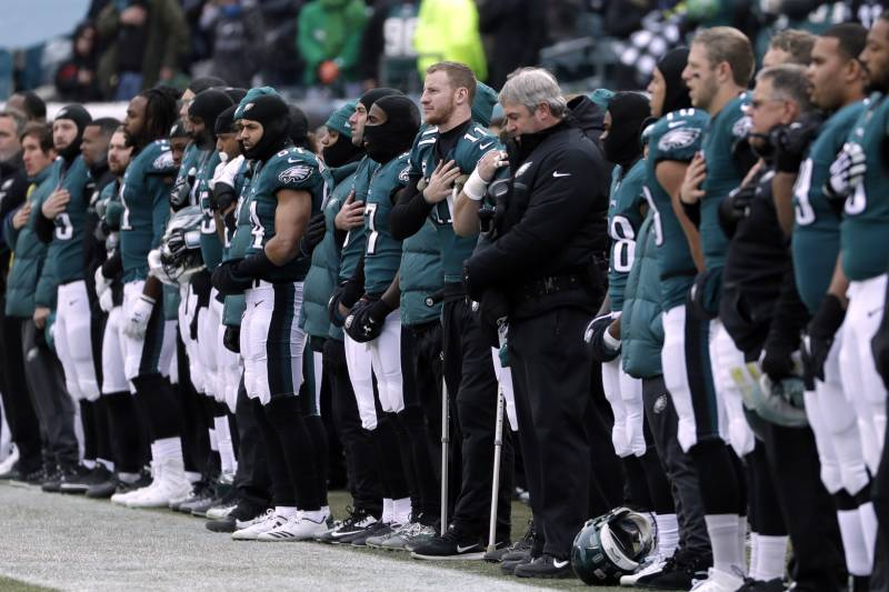 0418707f32b Philadelphia Eagles' Carson Wentz center, listens to the national anthem  before an NFL football