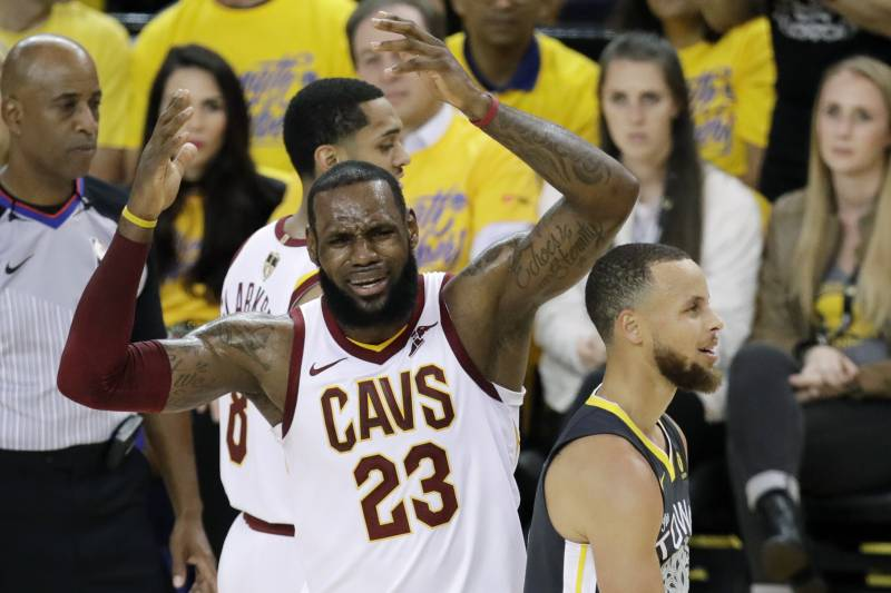 813362c14b20 Cleveland Cavaliers forward LeBron James (23) reacts next to Golden State  Warriors guard Stephen