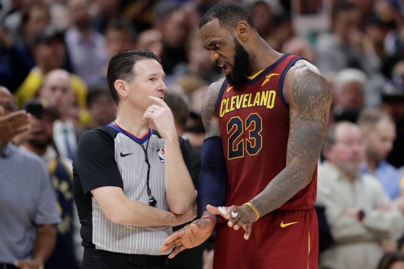 55e9a2da12e Cleveland Cavaliers  LeBron James (23) argues with referee Pat Fraher  during the second