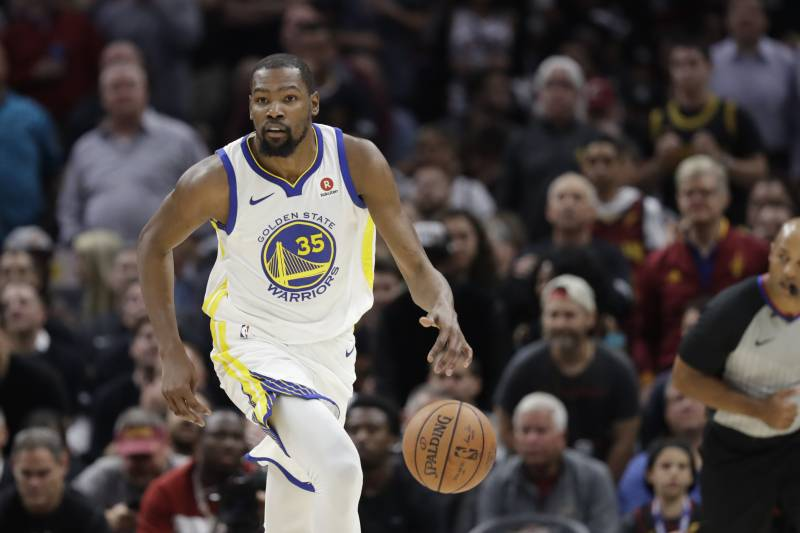e1ab85f6befa Golden State Warriors  Kevin Durant dribbles in the first half of Game 3 of  basketball s