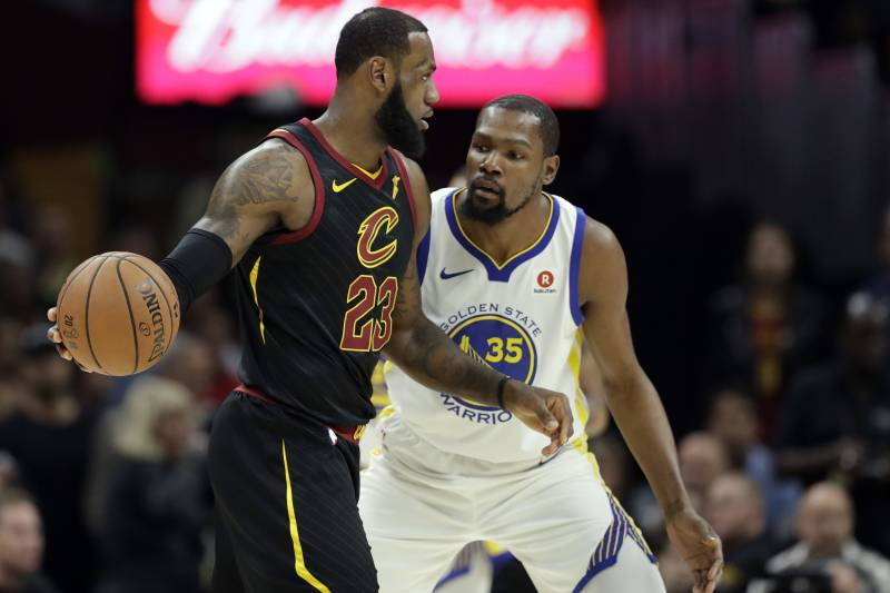 20f96ea81a66 Cleveland Cavaliers  LeBron James is defended by Golden State Warriors   Kevin Durant in the
