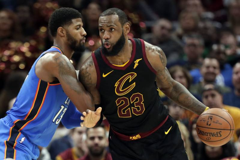 016478decd4 Cleveland Cavaliers' LeBron James, right, drives past Oklahoma City  Thunder's Paul George in