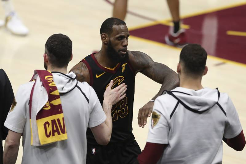 bd179d105b5 Cleveland Cavaliers  LeBron James greets teammates as he taken out in the  second half of