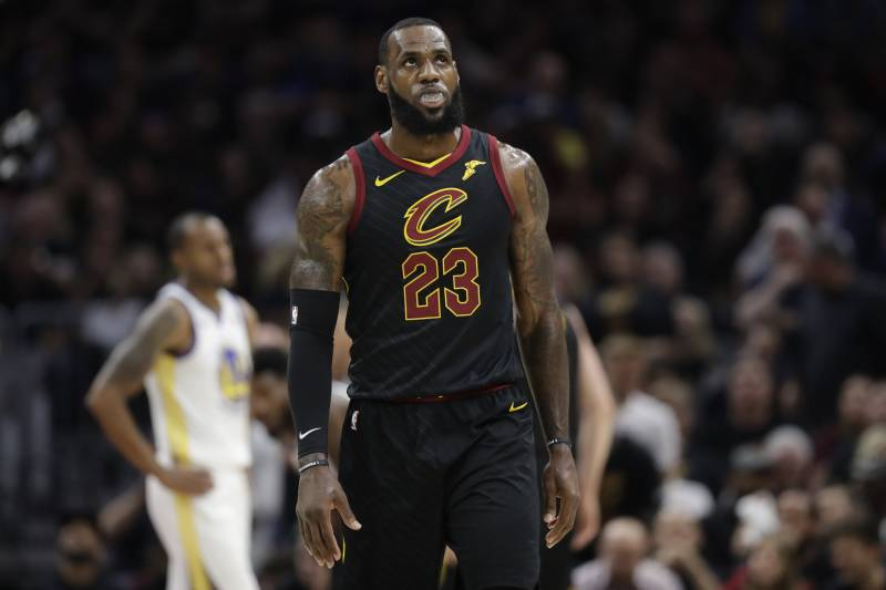 8e89f6b5be4 Cleveland Cavaliers' LeBron James in action in the first half of Game 4 of  basketball's