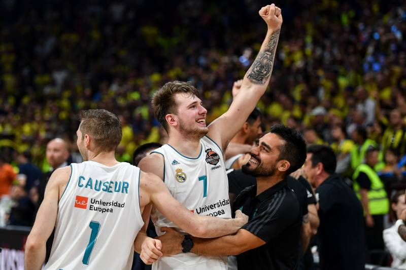 19eab7765fb TOPSHOT - Real Madrid s Slovenian Luka Doncic (R) celebrates with team mate  Real Madrid s