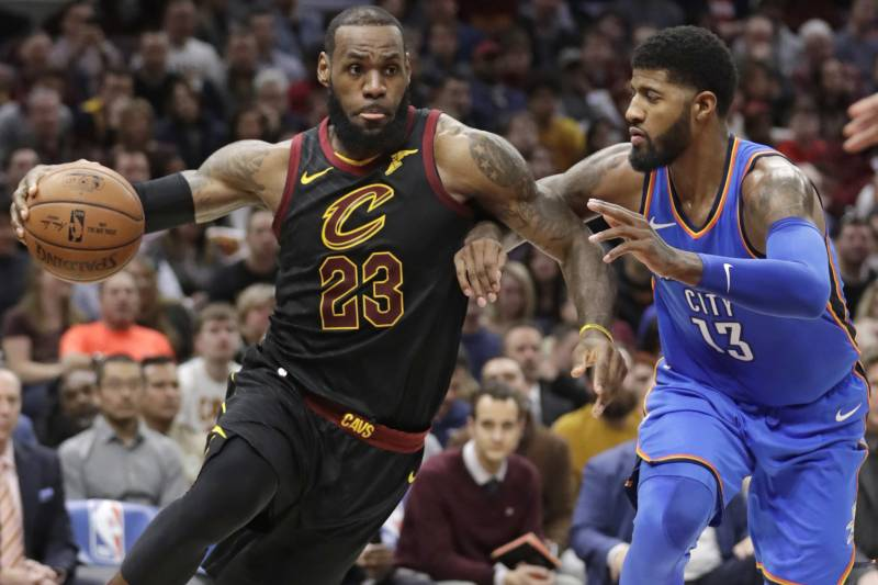 401613432 Cleveland Cavaliers  LeBron James (23) drives against Oklahoma City  Thunder s Paul George (