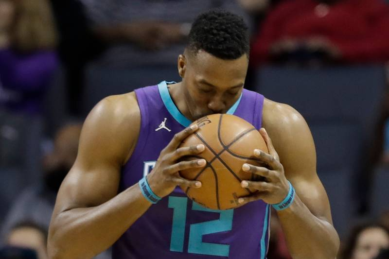 471ad7de82e4 Charlotte Hornets' Dwight Howard (12) kisses the basketball before the  start of an