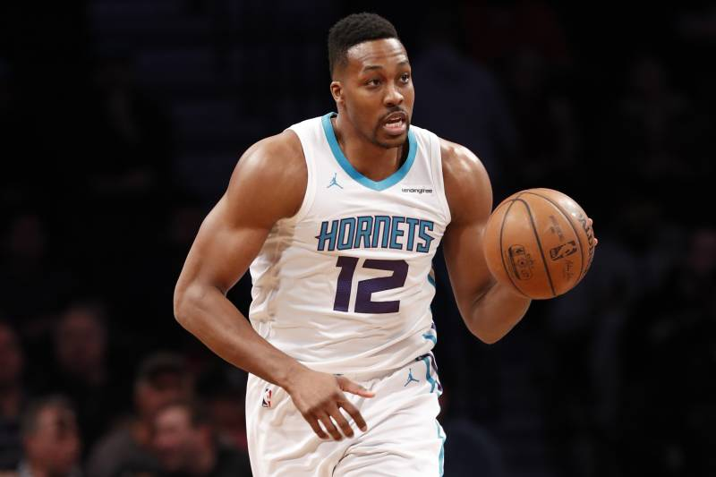 28a7ed032f8 Charlotte Hornets center Dwight Howard (12) moves the ball down court  during the first