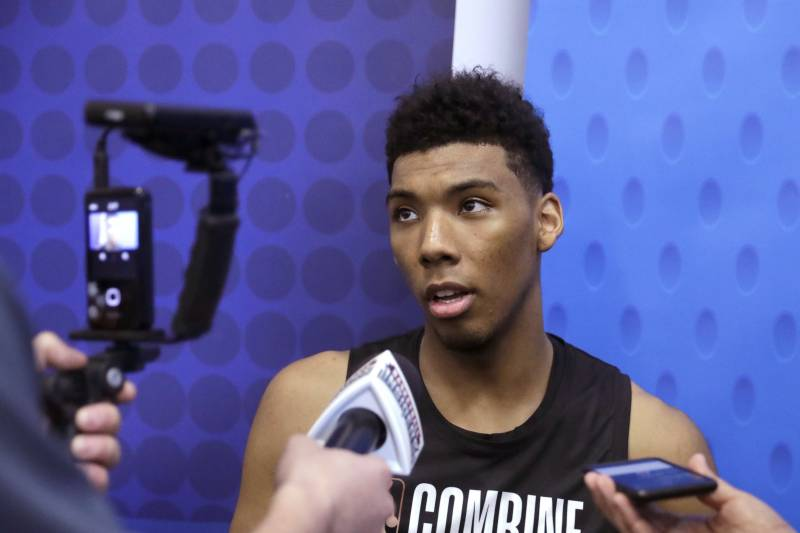 b9668b47ed8 Allonzo Trier, from Arizona, talks to reporters during the NBA basketball  draft combine Thursday