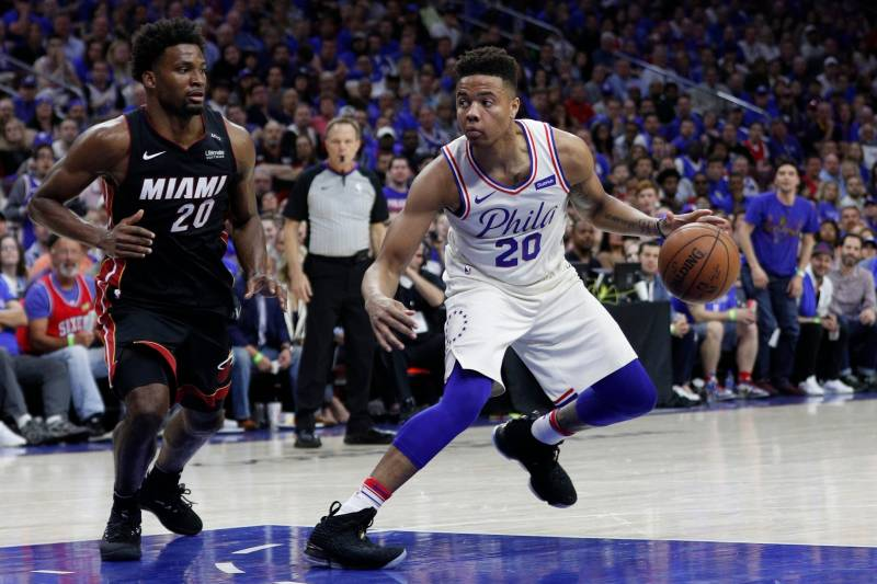 e979367624f Philadelphia 76ers' Markelle Fultz, right, in action against Miami Heat's  Justise Winslow,