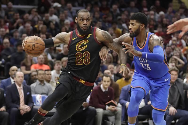 9047d434e14 Cleveland Cavaliers  LeBron James (23) drives against Oklahoma City  Thunder s Paul George (