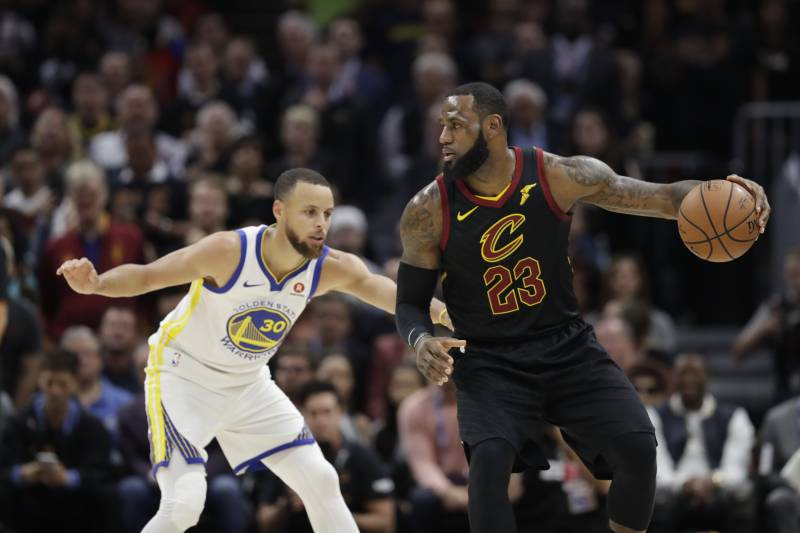 96e40f3fc3e5 Cleveland Cavaliers  LeBron James is defended by Golden State Warriors   Stephen Curry in the