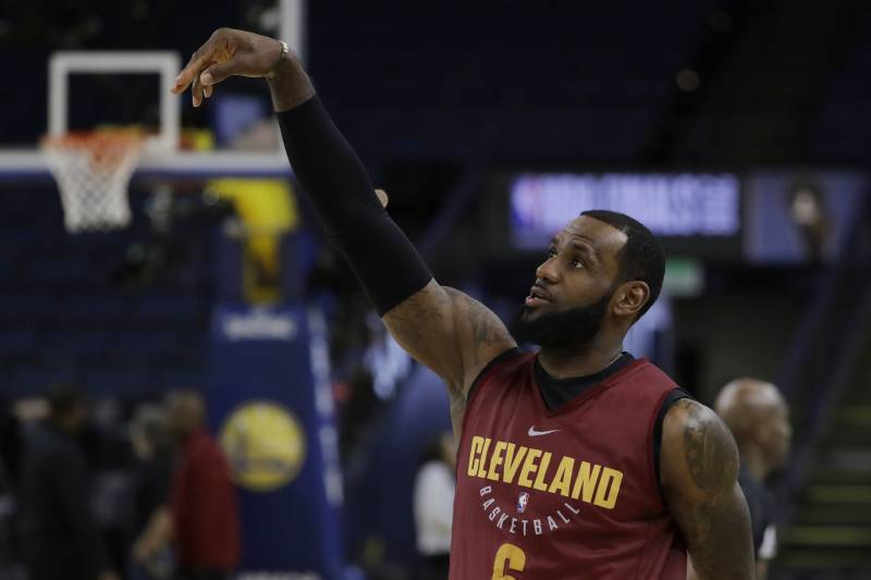 6d7313c3e941 Comments. Cleveland Cavaliers  LeBron James follows through on a shot  during an NBA basketball practice