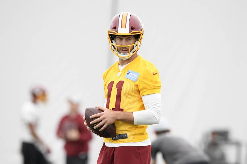 7145d066fa9 Washington Redskins quarterback Alex Smith holds the ball during an NFL  football team practice, Wednesday