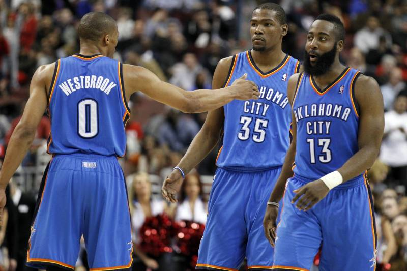 29099dcf Oklahoma City Thunder's Russell Westbrook, left, reacts with teammates  Kevin Durant (35)