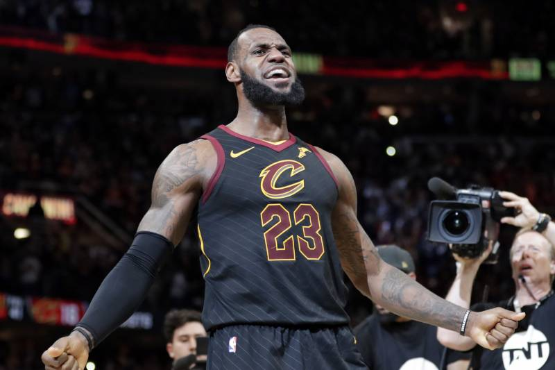 bb526be88c79 Cleveland Cavaliers  LeBron James reacts after making the game-winning shot  in the second